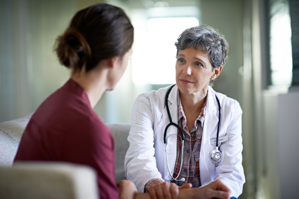 A compassionate doctor counselling her patient about medication-assisted treatment.
